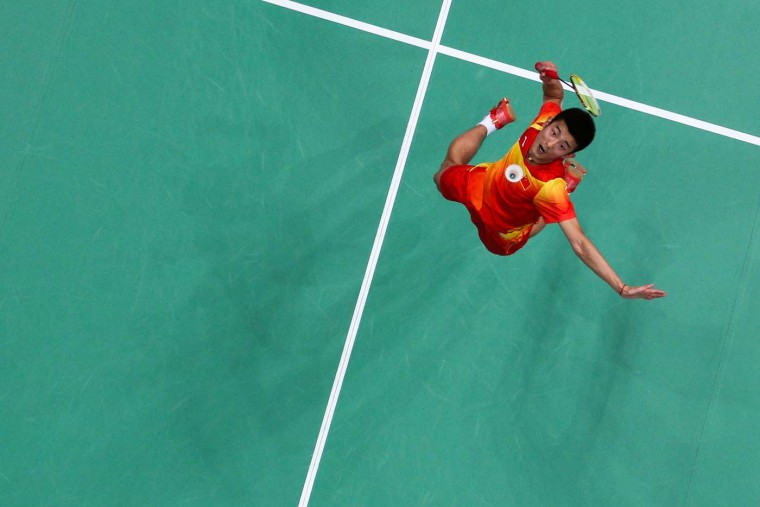 Chen Long of China returns a shot against Peter Gade of Denmark in their Men's Singles Badminton quarter final on day 6 of the London 2012 Olympic Games at Wembley Arena on August 2, 2012 in London, England. (Chris McGrath/Getty Images)