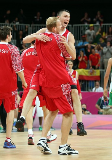 Vitaliy Fridzon #7 of Russia celebrates with teammate Anton Ponkrashov #14 after hitting a three-point shot to win the game 75-74 over Brazil during the Men's Basketball Preliminary Round match on Day 6 of the London 2012 Olympic Games at Basketball Arena on August 2, 2012 in London, England. (Christian Petersen/Getty Images)