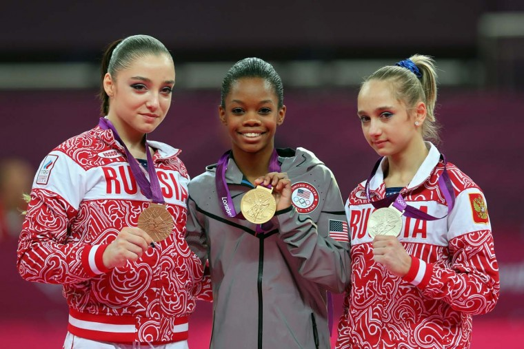 Bronze medalist Aliya Mustafina of Russia, gold medalist Gabrielle Douglas of the United States and silver medalist Victoria Komova of Russia pose after the medal ceremony in the Artistic Gymnastics Women's Individual All-Around final on Day 6 of the London 2012 Olympic Games. (Julian Finney/Getty Images)
