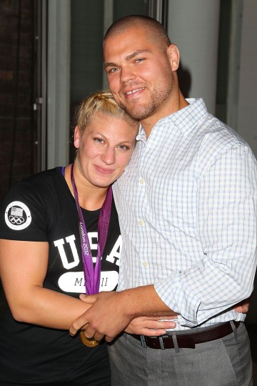 U.S. Olympian Kayla Harrison and fiance Aaron Handy visit the USA House at the Royal College of Art on August 2, 2012 in London, England. (Joe Scarnici/Getty Images for USOC)