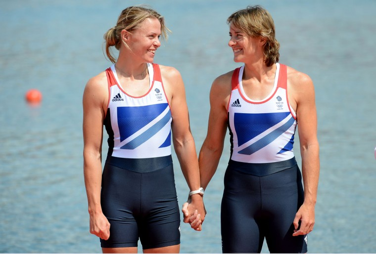 Katherine Grainger and Anna Watkins of Great Britain celebrate before receiving their gold medals during the medal ceremony for the Women's Double Sculls final on Day 7 of the London 2012 Olympic Games at Eton Dorney on August 3, 2012 in Windsor, England. (Harry How/Getty Images)