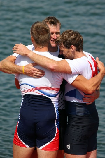 Gold medalist Mahe Drysdale (C) of New Zealand hugs silver medalist Ondrej Synek (L) of Czech Republic and bronze medalist Alan Campbell of Great Britain before receiving their medals during the medal ceremony for the Men's Single Sculls final on Day 7 of the London 2012 Olympic Games at Eton Dorney on August 3, 2012 in Windsor, England. (Phil Walter/Getty Images)