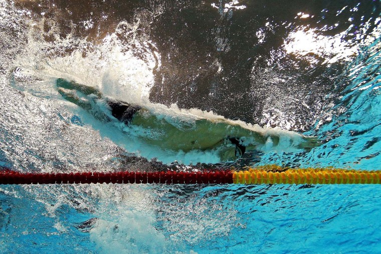 Michael Phelps of the United States dives into the pool in the Men's 100m Meldey Final on Day 8 of the London 2012 Olympic Games at the Aquatics Centre on August 4, 2012 in London, England. (Al Bello/Getty Images)