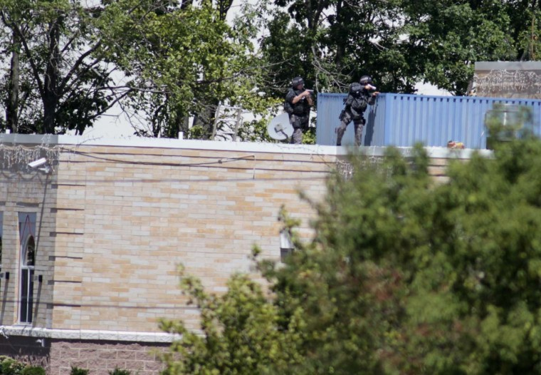 OAK CREEK, WI - AUGUST 5: Police SWAT officers surround the Sikh Temple of Wisconsin where at least one gunman stormed the mass and opened fire August, 5, 2012 Oak Creek, Wisconsin. At least six people were killed when a shooter, who was shot dead by a police officer, opened fire on congregants in the Milwaukee suburb. (Darren Hauck/Getty Images)
