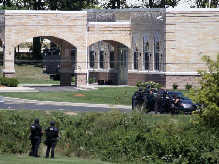 OAK CREEK, WI - AUGUST 5: Police SWAT officers surround the Sikh Temple of Wisconsin where at least one gunman stormed the mass and opened fire August, 5, 2012 Oak Creek, Wisconsin. (Darren Hauck/Getty Images)