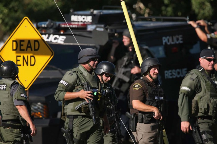 OAK CREEK, WI - AUGUST 05: Police work outside the Sikh Temple of Wisconsin where at least one gunman stormed the mass and opened fire August, 5, 2012 Oak Creek, Wisconsin. (Scott Olson/Getty Images)