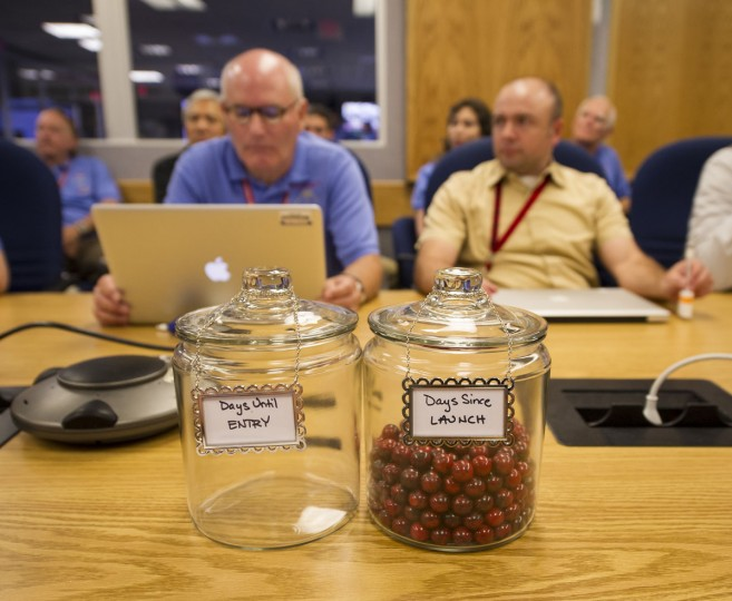 "In this handout image provided by NASA, an empty jar marked ""Days Until Entry"" and a jar full of marbles marked ""Days Since Launch"" sit on a conference room table during a meeting of the Mars Science Laboratory (MSL) team at the Jet Propulsion Laboratory in Pasadena, California. The MSL team has been moving one marble a day since launch from jar to jar. (Bill Ingalls/NASA via Getty Images)"