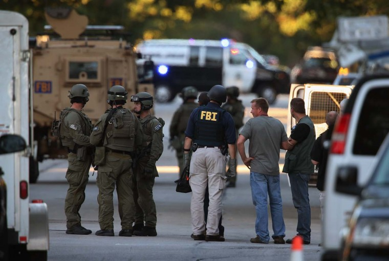 CUDAHY, WI - AUGUST 05: Police secure a neighborhood where the gunman lived who is suspected of opening fire at the Sikh Temple of Wisconsin August, 5, 2012 Cudahy, Wisconsin. (Scott Olson/Getty Images)