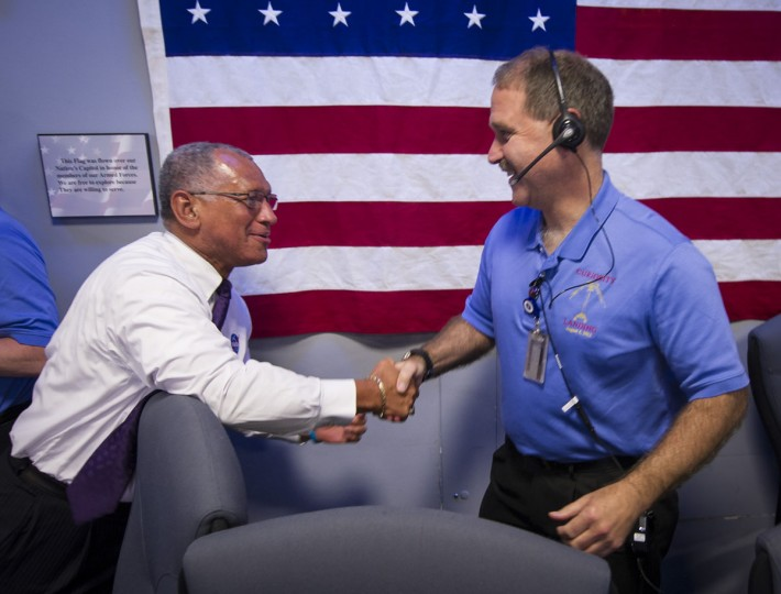 August 5, 2012: NASA Administrator Charles Bolden congratulates NASA Associate Administrator for the Science Mission Directorate John M. Grunsfeld, after the Mars Science laboratory (MSL) rover Curiosity successfully landed on Mars, inside the Spaceflight Operations Facility for NASA's Mars Science Laboratory Curiosity rover at Jet Propulsion Laboratory in Pasadena, California. (Brian van der Brug-Pool/Getty Images)