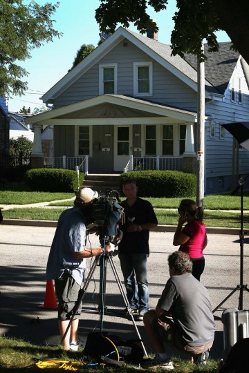 CUDAHY, WI - AUGUST 06: News crews report from outside the home of Wade Michael Page August 6, 2012 Cudahy, Wisconsin. Page is reported to have opened fire at the Sikh Temple of Wisconsin killing six people before being killed by police during a shootout. (Scott Olson/Getty Images)