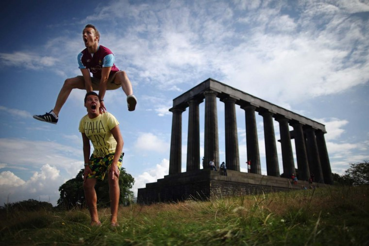 Members of the InSTEP theatre group take part in a photocall on Calton Hill to promote their show at the Edinburgh Fringe, 'Departure Lounge,' on August 6, 2012 in Edinburgh, Scotland. The Edinburgh Festival Fringe is the largest arts festivals in the world, it was established as an alternative to the International Festival also held in August, and celebrates it's 66th anniversary this year. (Dan Kitwood/Getty Images)