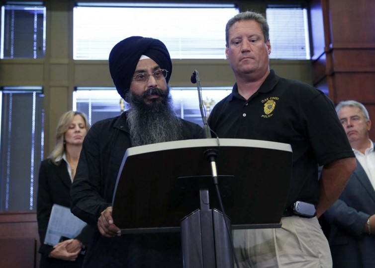 OAK CREEK, MI - AUGUST 6: Oak Creek Police Chief John Edwards (R) along with a member of the Sikh Church names victims of the shooting at the Sikh Temple of Wisconsin where yesterday a gunman fired upon people at service, at a press conference, August, 6, 2012 in Oak Creek, Wisconsin. (Darren Hauck/Getty Images)