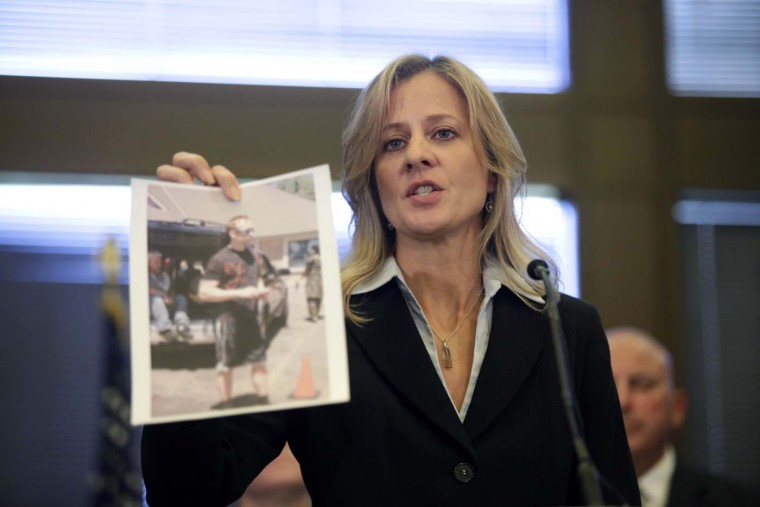 OAK CREEK - AUGUST 6: FBI specIal agent in charge, Teresa Carlson holds a photograph of a subject that the FBI wants to interview and is asking for any information as she speaks at a press conference on the shooting at the Sikh Temple of Wisconsin where yesterday a gunman fired upon people at service August, 6, 2012 in Oak Creek, Wisconsin. (Darren Hauck/Getty Images)