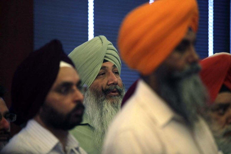 OAK CREEK, MI - AUGUST 6: Members of the Sikh community attend a press conference on the shooting at the Sikh Temple of Wisconsin where yesterday a gunman fired upon people at service August, 6, 2012 in Oak Creek, Wisconsin. (Darren Hauck/Getty Images)