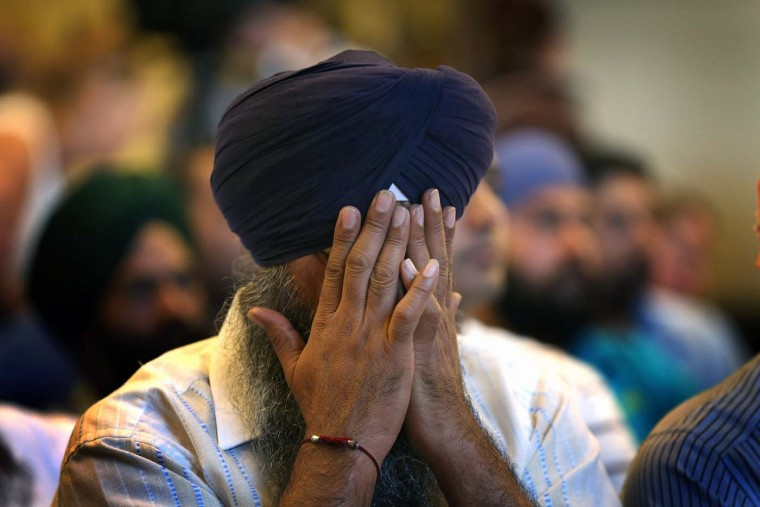 A member of the Miwaukee area Sikh community weeps as he listens to information about the shooting spree of Wade Michael Page August 6, 2012 in Oak Creek, Wisconsin. Page opened fire with a 9mm pistol at the Sikh Temple of Wisconsin killing six people before being killed by police in a shootout. (Scott Olson/Getty Images)