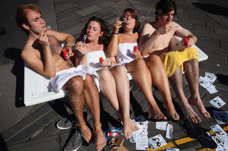 Street entertainers sit in a bath tub and blow bubbles as they perform on the Royal Mile to promote their shows during in the Edinburgh Fringe Festival in Edinburgh, Scotland. The Edinburgh Festival Fringe is the largest arts festivals in the world; established as an alternative to the International Festival also held in August, and celebrates it's 66th anniversary this year. (Dan Kitwood/Getty Images)