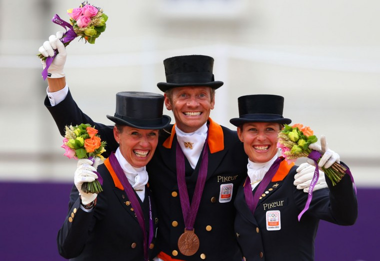 (L-R) Charlotte Dujardin, Carl Hester and Laura Bechtolsheimer of Great Britain celebrate with their gold medals during the medal cerermony for the Team Dressage on Day 11 of the London 2012 Olympic Games at Greenwich Park in London, England. (Alex Livesey/Getty Images)