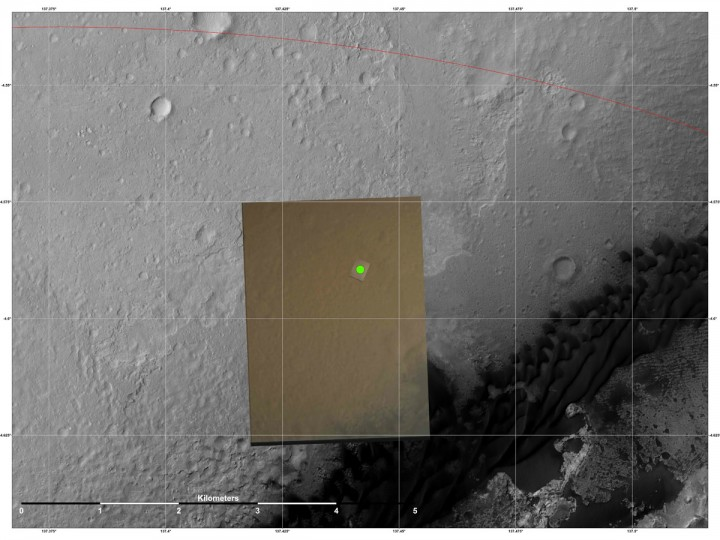 August 8, 2012: This is the location (green) where scientists estimate NASA's Curiosity rover landed on Mars within Gale Crater, based on images from the Mars Descent Imager (MARDI). The landing estimates derived from navigation and landing data agree to within 660 feet (200 meters) of this MARDI estimate. The red line shows the northern edge of the targeted landing region, a probability distribution defined by an ellipse. The gray scale image is a mosaic from the HiRISE camera on NASA's Mars Reconnaissance Orbiter. The color image is from MARDI. (NASA/JPL-Caltech/MSSS/University of Arizona/Getty Images)