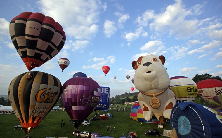 Hot air balloons take to the skies from Ashton Court at the Bristol International Balloon Fiesta in Bristol, England. (Matt Cardy/Getty Images)