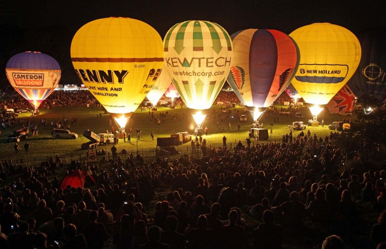 Hot air balloons take part in a illuminated night glow at Ashton Court at the Bristol International Balloon Fiesta in Bristol, England. Now in its 34th year, the Bristol International Balloon Fiesta is Europe's largest annual hot air balloon event. (Matt Cardy/Getty Images)