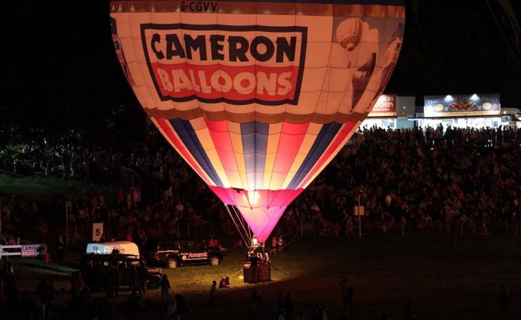 Hot air balloons take part in a illuminated night glow at Ashton Court at the Bristol International Balloon Fiesta in Bristol, England. (Matt Cardy/Getty Images)
