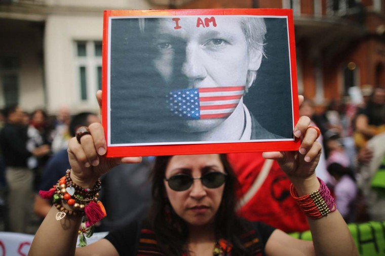 Protesters gather outside the Ecuadorian Embassy, where Julian Assange, founder of Wikileaks is staying in London, England. Mr Assange has been living inside Ecuador's London embassy since June 19, 2012 after requesting political asylum whilst facing extradition to Sweden to face allegations of sexual assault. (Dan Kitwood/Getty Images)