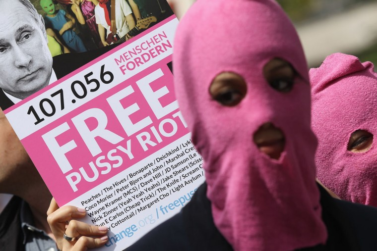 BERLIN, GERMANY - AUGUST 17: Supporters of the Russian female punk band Pussy Riot protest outside the Russian embassy on August 17, 2012 in Berlin, Germany. A Moscow court is scheduled to announce a verdict in the trial of the three musicians later today in a case that has attracted global attention over the issues of freedom of speech and artistic expression in modern Russia. (Sean Gallup/Getty Images)