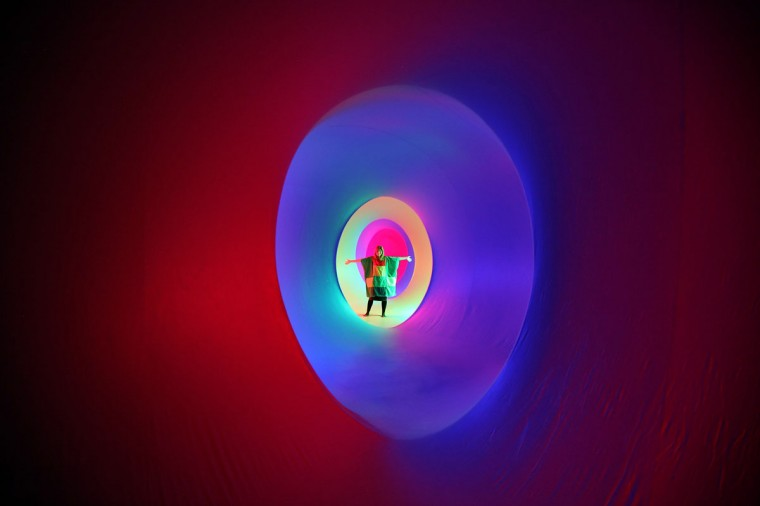 Vikki Strode explores Colourscape on the front lawn of Holburne Museum in Bath, England. Billed as the museum's summer event, the Colourscape Music Festival, which opens tomorrow and runs until August 27, is a labyrinth of inflatable interconnected chambers flooded with coloured light which forms a walk-in sculpture of colour, light and sound. (Matt Cardy/Getty Images)