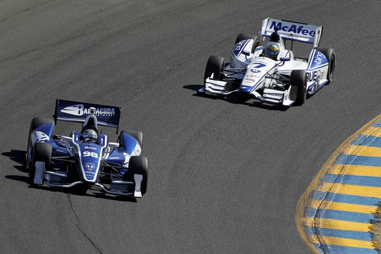 Alex Tagliani, driver of the #98 Team Barracuda-BHA Honda, drives with Sebastian Bourdais, driver of the #7 TrueCar Dragon Racing Chevrolet, during practice for the GoPro Indy Grand Prix at Sonoma on August 24, 2012 in Sonoma, California. (Todd Warshaw/Getty Images)