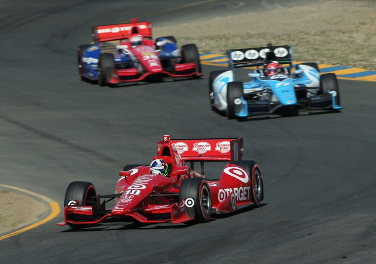 Dario Franchitti, driver of the #10 Target Chip Ganassi Racing Honda, leads a pack of cars into a turn during the GoPro Indy Grand Prix of Sonoma at Sonoma on August 26, 2012 in Sonoma, California. (Jeff Gross/Getty Images)