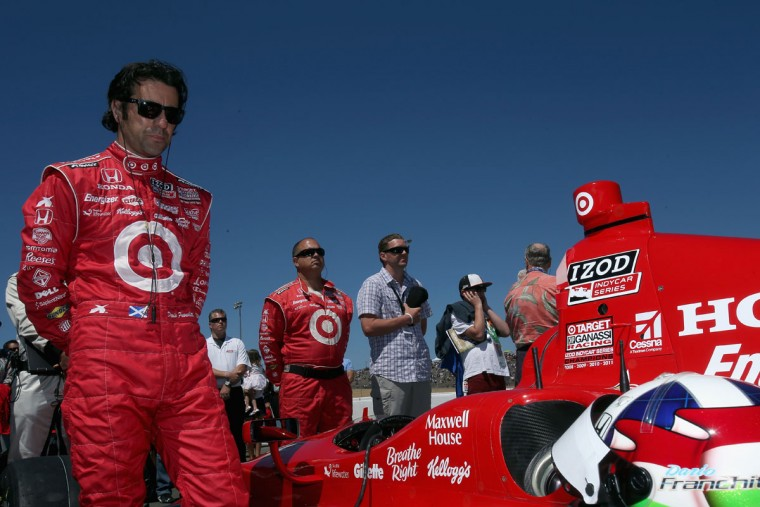 Dario Franchitti, driver of the #10 Target Chip Ganassi Racing Honda, observes the National Anthem prior to the start of the GoPro Indy Grand Prix of Sonoma at Sonoma on August 26, 2012 in Sonoma, California. (Jeff Gross/Getty Images)