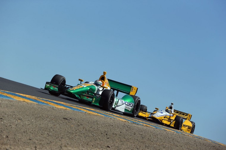 Justin Wilson, driver of the #18 Dale Coyne Racing Honda leads Helio Castroneves in the #3 Team Penske Chevrolet, over a hill during the GoPro Indy Grand Prix of Sonoma at Sonoma on August 26, 2012 in Sonoma, California. (Jeff Gross/Getty Images)
