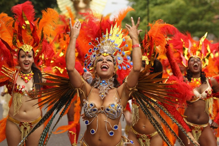 Revellers perform at the Notting Hill Carnival on August 27, 2012 in London, England. The annual 2-day carnival, which is the largest of its kind in Europe and is expected to attract around 1 million revellers, has taken place every August Bank Holiday since 1966. (Oli Scarff/Getty Images)