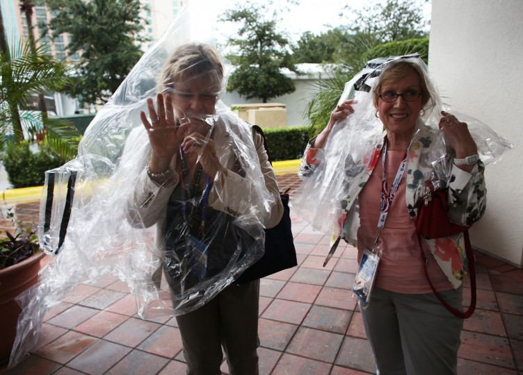 Two women wear plastic bags as shelter from the bad weather before the start of the abbreviated first day of the Republican National Convention outside the Tampa Bay Times Forum on August 27, 2012 in Tampa, Florida. The RNC is scheduled to convene today, but will hold its first full session tomorrow after being delayed due to Tropical Storm Isaac. (Win McNamee/Getty Images)