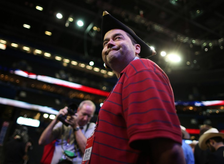 A man with a tri-corner hat stands on the arena floor before the start of the abbreviated first day of the Republican National Convention at the Tampa Bay Times Forum on August 27, 2012 in Tampa, Florida.(Chip Somodevilla/Getty Images)