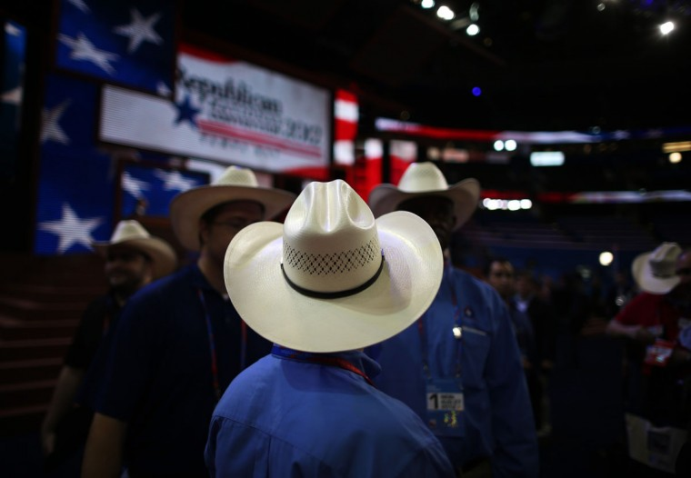 Men wearing cowboy hats stand on the arena floor before the start of the abbreviated first day of the Republican National Convention at the Tampa Bay Times Forum on August 27, 2012 in Tampa, Florida. (Chip Somodevilla/Getty Images)