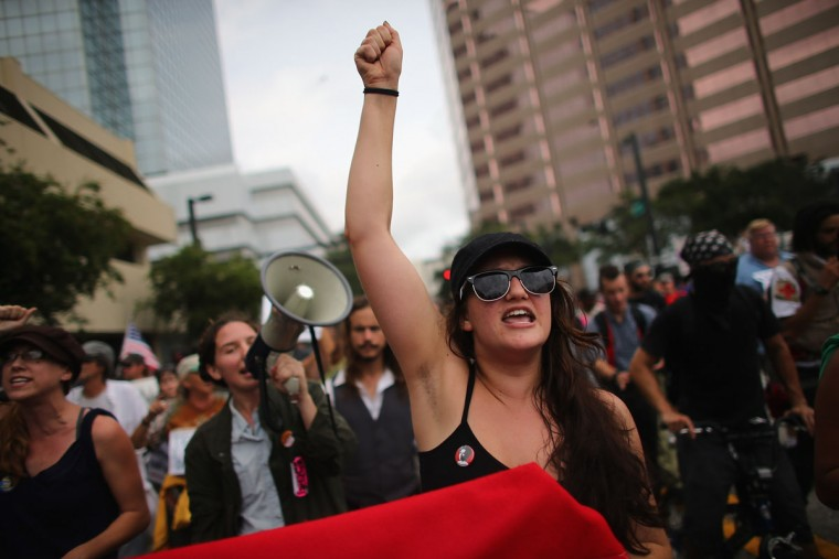 Protesters walk through the streets before the start of the Republican National Convention being held at the Tampa Bay Times Forum on August 27, 2012 in Tampa, Florida. (Joe Raedle/Getty Images)