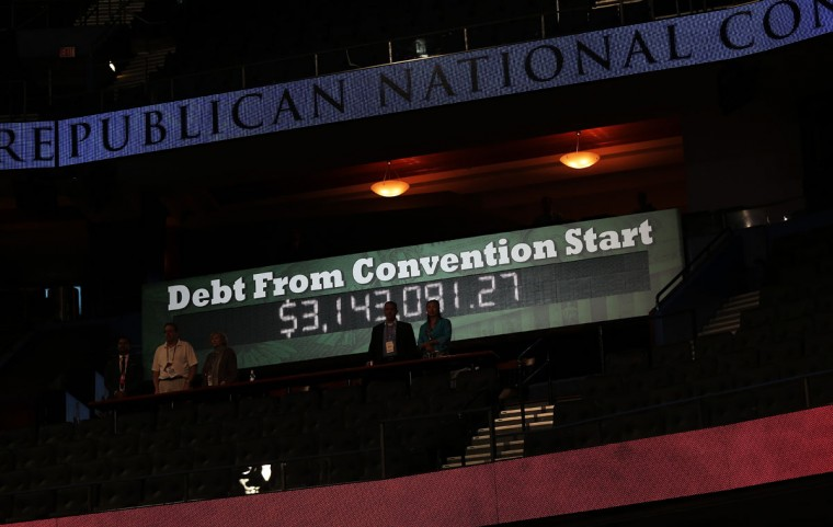 A display shows the collected national debt since the start of the Republican National Convention at the Tampa Bay Times Forum on August 27, 2012 in Tampa, Florida. (Win McNamee/Getty Images)