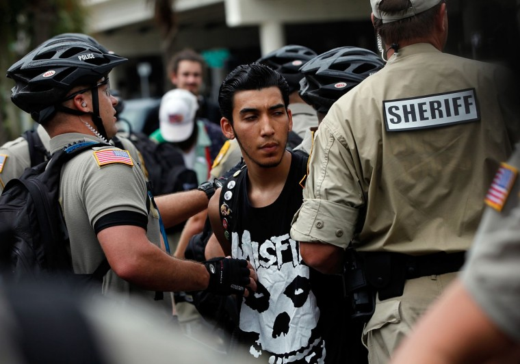 Law enforcement officers arrest a protester during a demonstration on August 27, 2012 in Tampa, Florida. The demonstration was being held just before of the start of the Republican's nominating convention. (Tom Pennington/Getty Images)