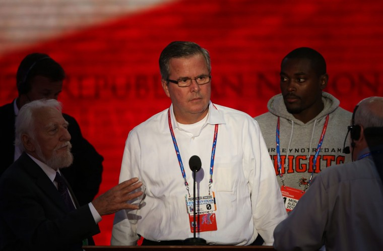 Former Florida Gov. Jeb Bush (C) appears on stage for a sound check during the Republican National Convention at the Tampa Bay Times Forum on August 27, 2012 in Tampa, Florida. (Mark Wilson/Getty Images)
