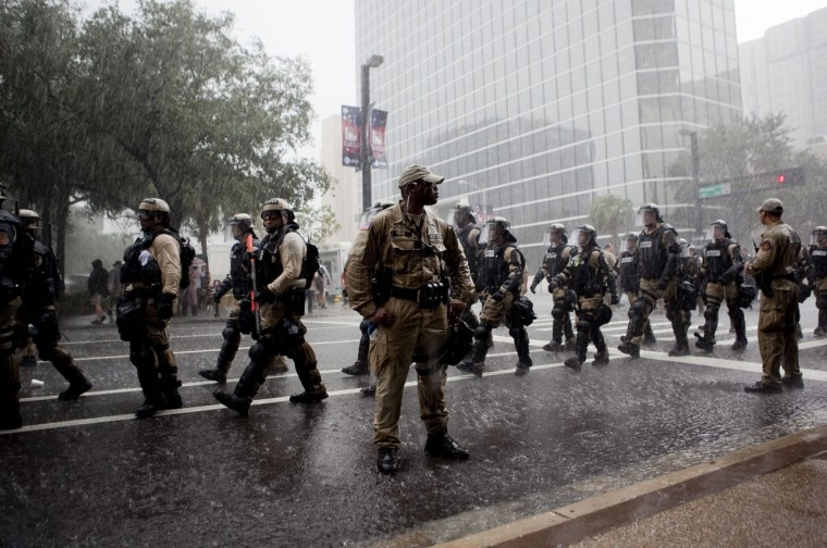 Law enforcement officers wearing riot gear leave the scene where a peaceful march ended during the National Republican Convention on August 27, 2012 in downtown Tampa, Florida. Commercial bus cancellations due to Tropical Storm Isaac have prevented many of the expected demonstrators from being present. (Edward Linsmier/Getty Images)