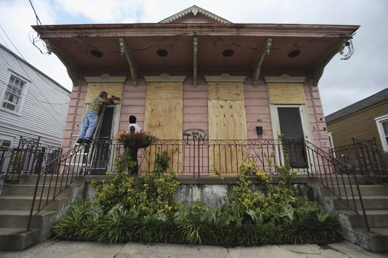 Claudia and Richard Launey board up their home before Hurricane Isaac, which still bears a marking from Hurricane Katrina,in New Orleans, Louisiana. New Orleans is bracing for the approach of Hurricane Isaac, now a Category 1 storm. (Mario Tama/Getty Images)