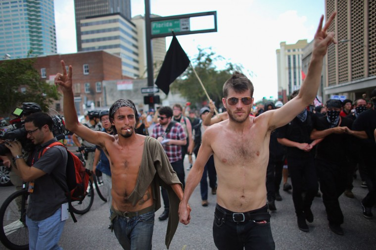 Protesters walk together through the streets on the first full day of the Republican National Convention at the Tampa Bay Times Forum in Tampa, Florida. (Joe Raedle/Getty Images) ORG XMIT: 150796058