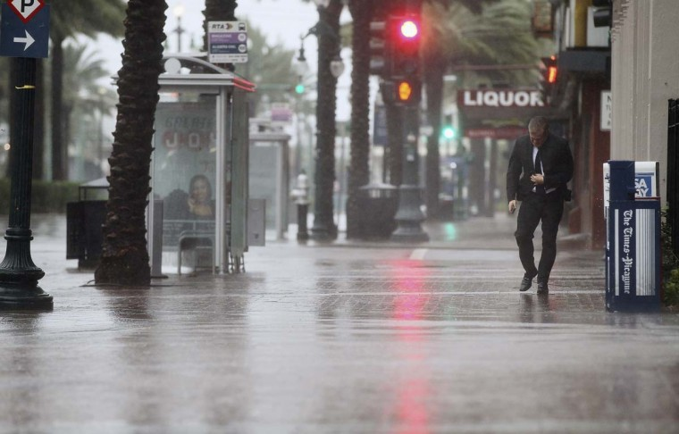 A man walks on Canal Street in New Orleans, Louisiana. New Orleans was bracing for the approach of Hurricane Isaac, now a Category 1 storm, which hit the city on August 29. (Mario Tama/Getty Images)
