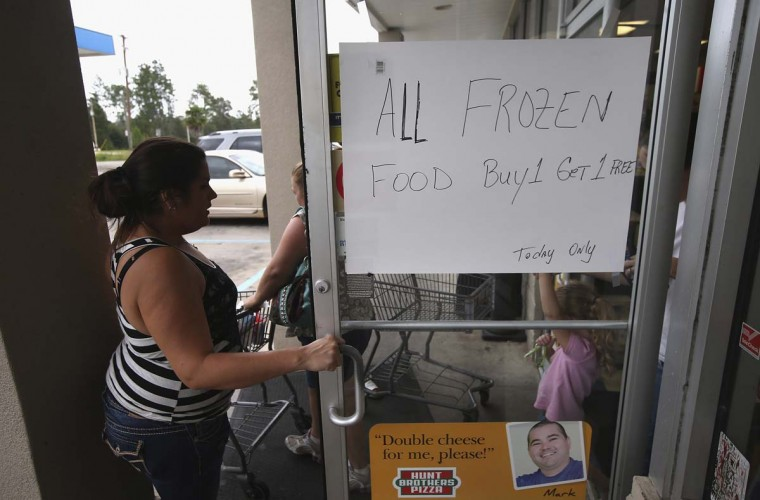 Residents stock up at Seal's Marketplace in Kiln, Mississippi. Store owner Michael Seal said he put all his frozen items on sale, both for the benefit of his local clients and also to reduce his stock. (John Moore/Getty Images)