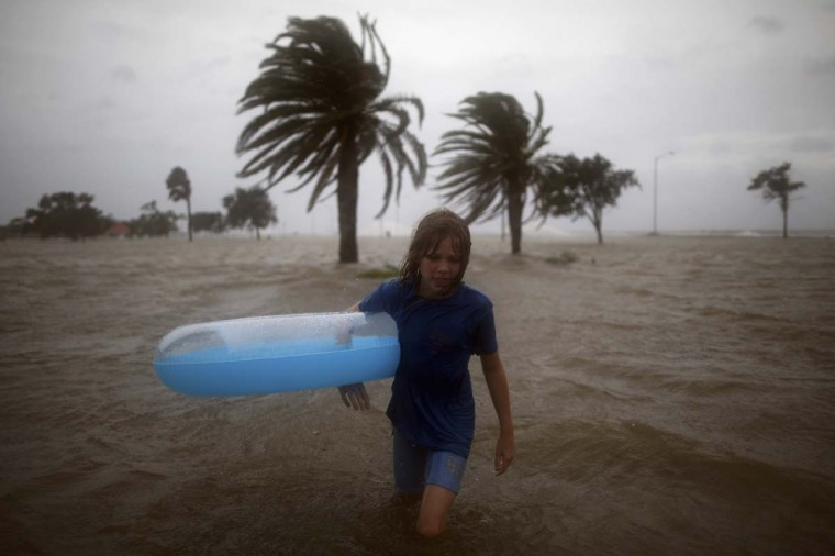 Juliane Fincher plays in the water of Lake Pontchatrain as Hurricane Isaac approaches. (Chris Graythen/Getty Images)