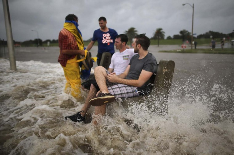 A group of men sit on a bench at the edge of Lake Pontchatrain as Hurricane Isaac approaches. (Chris Graythen/Getty Images)