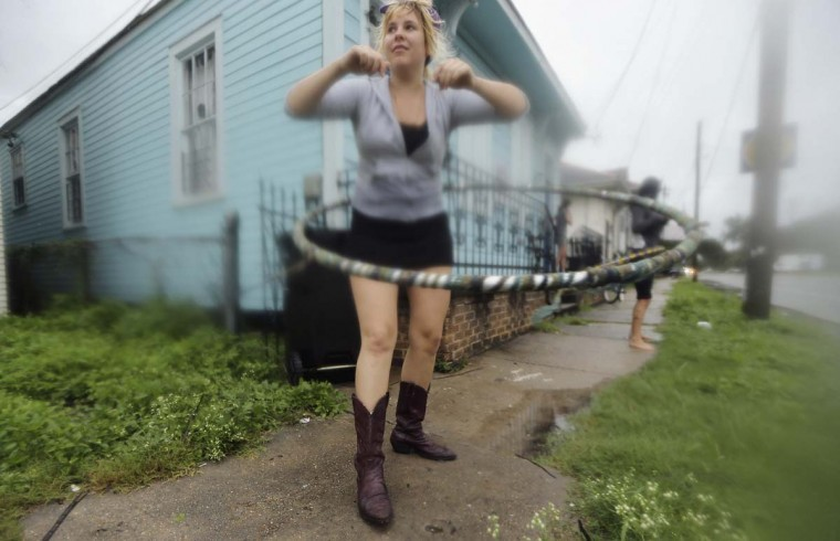 Kat Soulagnet hula hoops at a 'Hurricane Party' in the Upper Ninth Ward in New Orleans, Louisiana. (Mario Tama/Getty Images)
