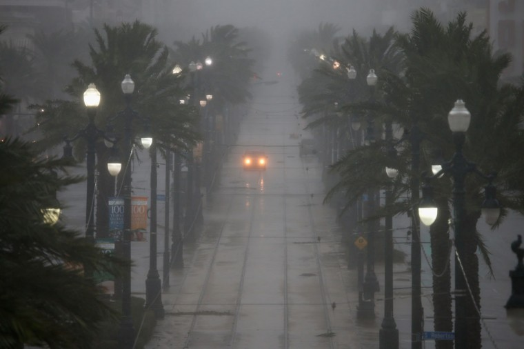A car drives down Canal Street during Hurricane Isaac on August 29, 2012 in New Orleans, Louisiana. The Category 1 hurricane is slowly moving across southeast Louisiana, dumping large amounts of rain and knocking out power to Louisianans in scattered parts of the state. (Chris Graythen/Getty Images)