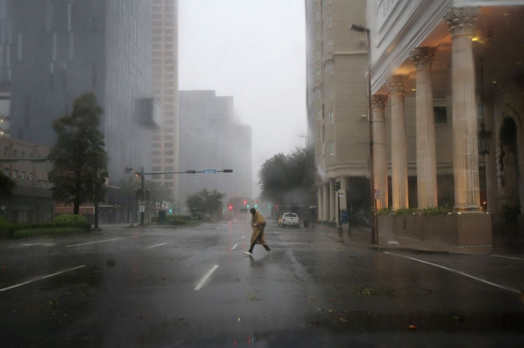 A pedestrian walks through the rain of Hurricane Isaac on August 29, 2012 in New Orleans, Louisiana. The Category 1 hurricane is slowly moving across southeast Louisiana, dumping large amounts of rain and knocking out power to Louisianans in scattered parts of the state. (John Moore/Getty Images)